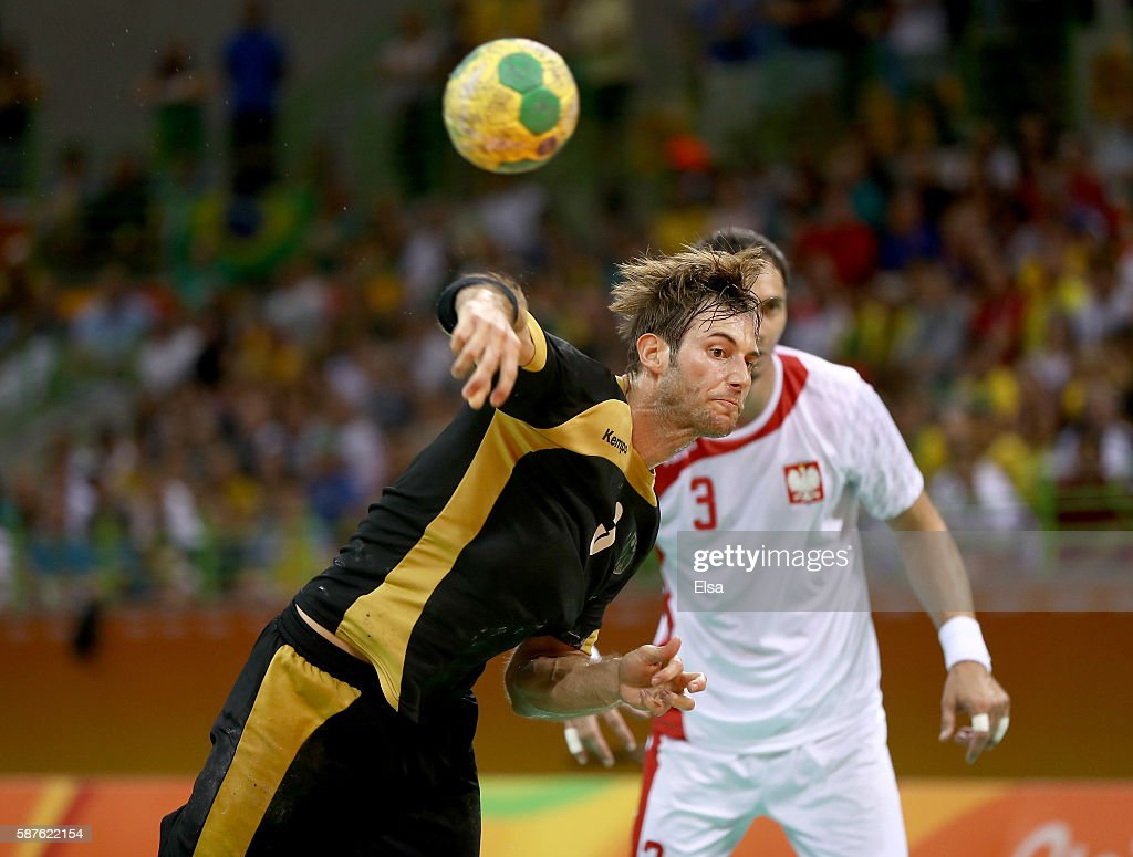 Uwe Gensheimer of Germany takes a 7 meter shot as Krzysztof Lijewski of Poland stands by on Day 4 of the Rio 2016 Olympic Games at the Future Arena...
