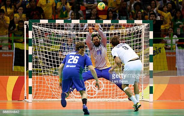 Uwe Gensheimer of Germany throws a penalty on the head of goalkeeper Cesar Augusto Almeida of Brazil during the Mens Preliminary Group B match...