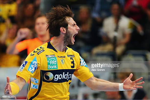 Uwe Gensheimer of RheinNeckar Loewen celebrates a goal during the DKB Handball Bundesliga match between RheinNeckar Loewen and HSV Hamburg at SAP...