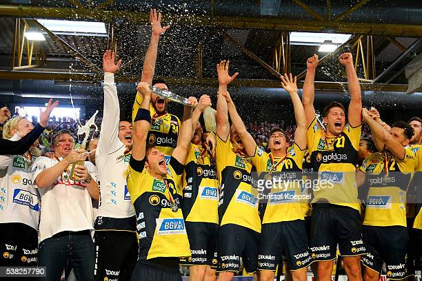 #Uwe Gensheimer of RN Loewen lifts the German Championship trophy after the DKB Handball Bundesliga match between TuS NLuebbecke and RN Loewen at...