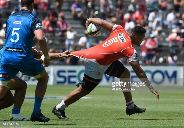Uwe Helu of the Sunwolves fights off a tackle by Blues players during the Super Rugby match between the Sunwolves of Japan and the Blues of New...