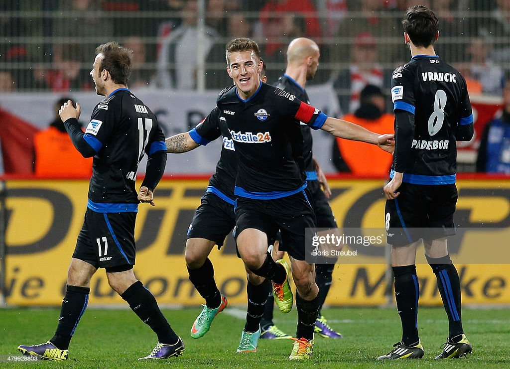 Uwe Huenemeier of Paderborn celebrates with team mates after scoring his team's first goal during the Second Bundesliga match between 1FC Union...
