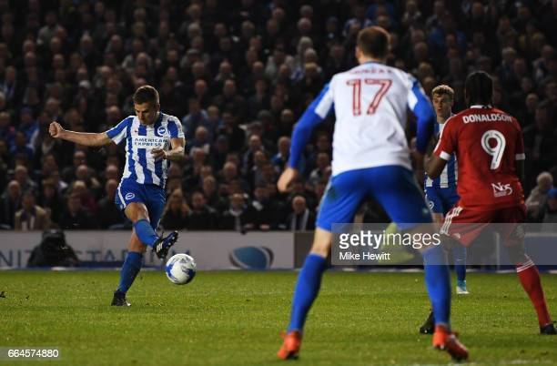 Uwe Hunemeier of Brighton and Hove Albion scores his sides third goal during the Sky Bet Championship match between Brighton Hove Albion and...