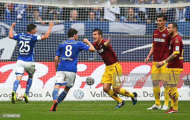 Uwe Hunemeier of SC Paderborn reacts after heading the ball into his own goal during the Bundesliga match between FC Schalke 04 and SC Paderborn at...