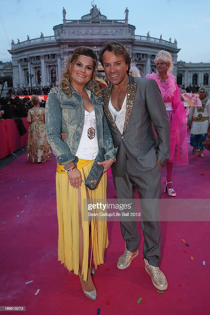 Uwe Kroeger and a friend arrive on the Magenta Carpet at the 2013 Life Ball at City Hall on May 25, 2013 in Vienna, Austria.