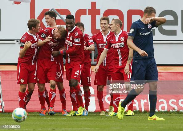 Uwe Moehrle of Cottbus celebrates with team mates after scoring the first goal during the third league match between FC Energie Cottbus and FC Hansa...