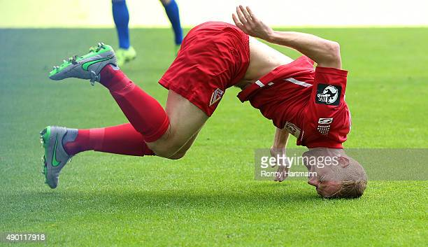Uwe Moehrle of Cottbus falls to the ground during the Thrid League match between 1 FC Magdeburg and Energie Cottbus at MDCCArena on September 26 2015...