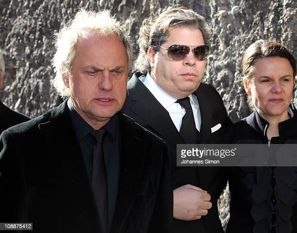 Uwe Ochsenknecht Thomas Friedl and Julia Friedl attend the memorial service for Bernd Eichinger at the St Michael Kirche on February 07 2011 in...