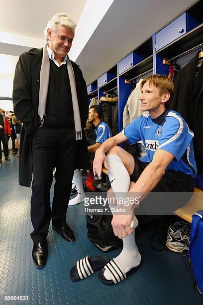 Uwe Rapolder talks to Detlev Dammeier prior the Ansgar Brinkmann Farewell Match at the Schueco Arena on March 27 2009 in Bielefeld Germany