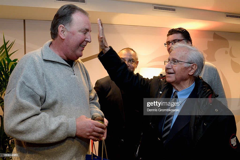 Uwe Reinders of Germany and former french head coach Michel Hidalgo joke during a meeting of the 1982 World Cup teams of France and Germany on February 6, 2013 in Paris, France.