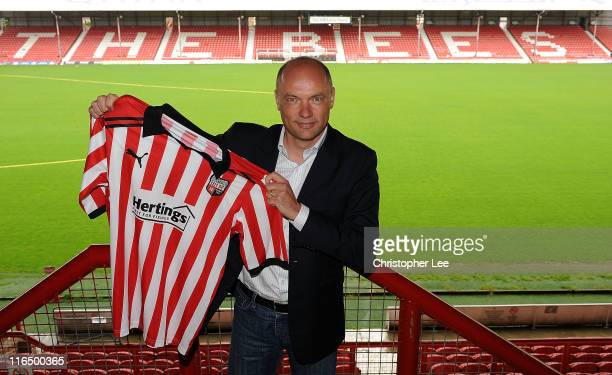 Uwe Rosler holds up his new club's shirt as he is announced as the new manager of Brentford FC at Griffin Park on June 16 2011 in Brentford England