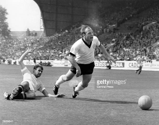 Uwe Seeler West Germany's star centre forward is fouled by Uruguay's Manicera in the World Cup quarter final at Hillsborough Sheffield West Germany...