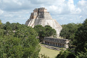 Pyramid of the Magician and Colonnade Structure at Uxmal Archeological Site in the Puuc Region of the Yucatan Peninsula near Merida, Mexico.