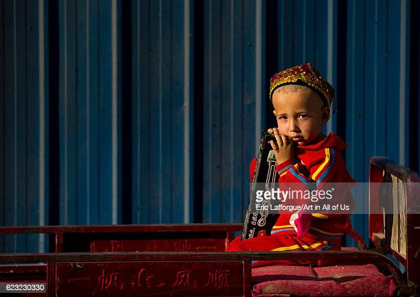 Uyghur boy waiting in a cart Yarkand Xinjiang Uyghur Autonomous Region China on September 19 2012 in Yarkand China