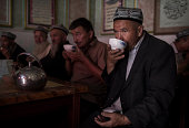 Uyghur man drinks tea at a restaurant on August 1 2014 in old Kashgar Xinjiang Uyghur Autonomous Region China Nearly 100 people have been killed in...