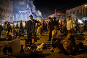 Uyghur man looks at pants for sale before the Eid holiday at a night market on July 28 2014 in old Kashgar Xinjiang Uyghur Autonomous Region China...