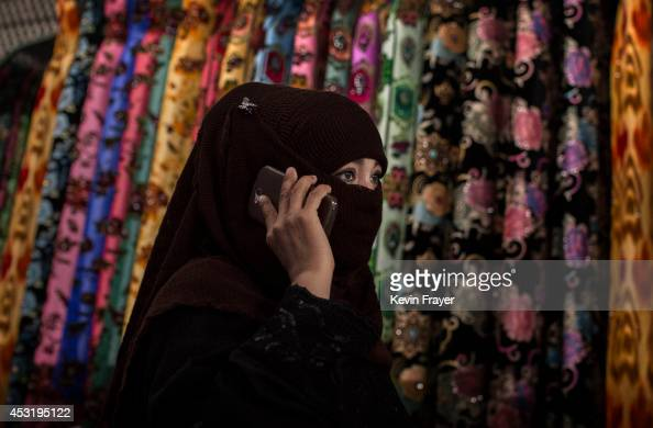 Uyghur woman wears a veil as she shops at a local market on August 2 2014 in Kashgar Xinjiang Uyghur Autonomous Region China Nearly 100 people have...