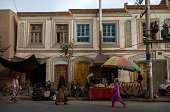 Uyghurs walk in the street on July 27 2014 in old Kashgar Xinjiang Uyghur Autonomous Region China Nearly 100 people have been killed in unrest in the...