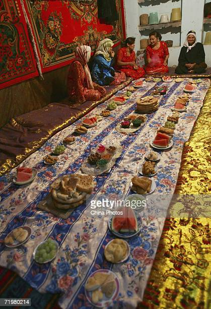 A Uygur family wait for guests before a wedding ceremony on September 21 2006 in Kashi of Xinjiang Uygur Autonomous Region northwest China Kashi is...