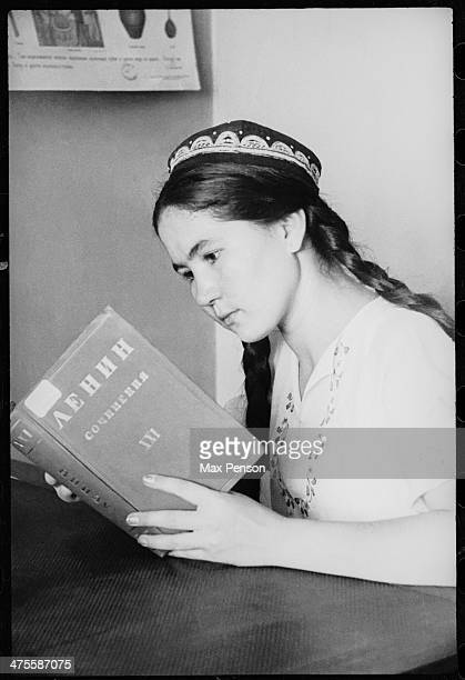 Uzbek girl reading a volume from Lenin's collection of works Uzbekistan circa 1940