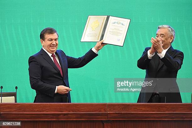 Uzbek Presidentelect Shavkat Mirziyoyev receives certificate of election from the Central election committee MirzaUlugbek Abdusalomov during his...