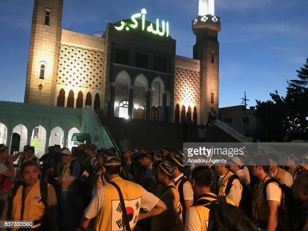 Uzbek prospective Muslim pilgrims who live in South Korea gather at Seoul Central Mosque for their departure to Mecca in Seoul South Korea on August...