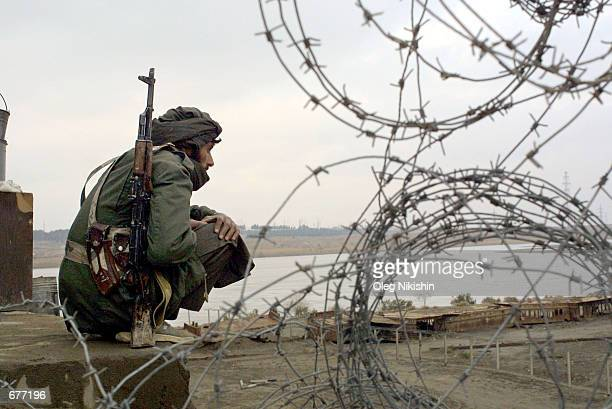 Uzbek soldier stands guard December 9 2001 at the border of Uzbekistan and Afghanistan The Friendship Bridge which is located at the border was...