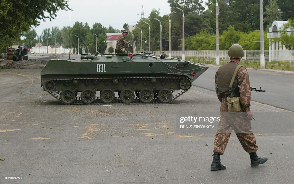 Uzbek soldiers patrol around an armored personnel carrier in the center of the Uzbek town of Andijan 15 May 2005 Human Rights Watch blasted hardline...