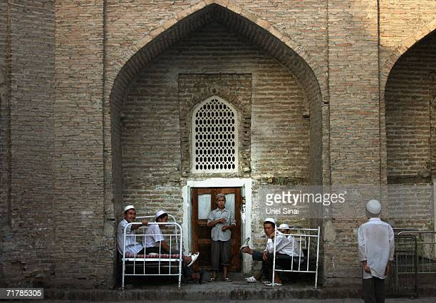 Uzbek youth gather in the courtyard of the local mosque and madrasa where they live and study Islam on August 12 2006 in Kukand near Margilan in the...