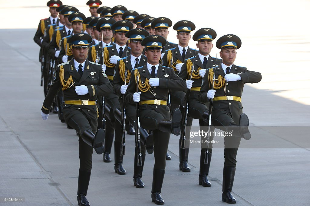 Uzbekistan Army guards march priot to arrival of Russian President Vladimir Putin (not pictured) at the Tashkent International Airport in Tashkent, Uzbekistan, June, 23, 2016. Putin has arrived to Uzbekistan to attend the Shanghai Cooperation Organisation (SCO) Summit.