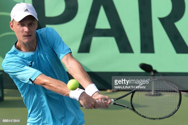 Uzbekistan player Sanjar Fayziev plays a shot during his singles match against Ramkumar Ramanathan at the Davis Cup Asia Oceania group one tie match...