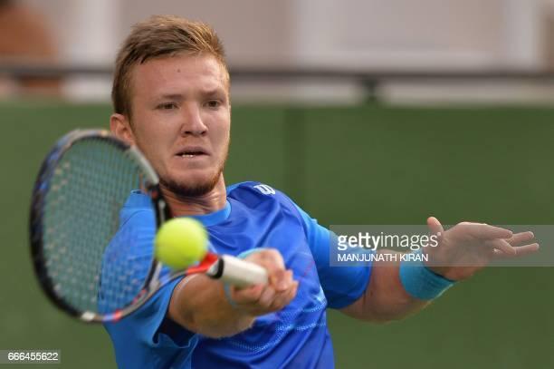 Uzbekistan player Temur Ismailov plays a shot during his singles match against Prajnesh Gunneswaran at the Davis Cup Asia Oceania group one tie match...