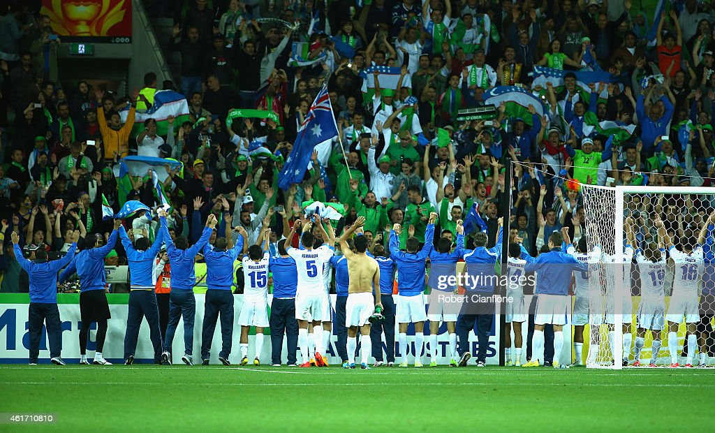 Uzbekistan players and officials celebrate after they defeated Saudi Arabia during the 2015 Asian Cup match between Uzbekistan and Saudi Arabia at...