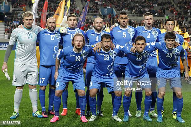 Uzbekistan players line up for the team photos prior to the 2018 FIFA World Cup qualifying match between South Korea and Uzbekistan at Seoul World...
