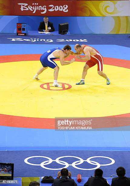 Uzbekistan's Artur Taymazov and Russia's Bakhtiyar Akhmedov fight during their men's 120kg freestyle gold medal wrestling match at the Beijing 2008...