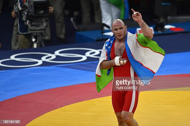 Uzbekistan's Artur Taymazov celebrates after defeating Georgia's Davit Modzmanashvili in their Men's 120kg gold medal match on August 11 2012 during...