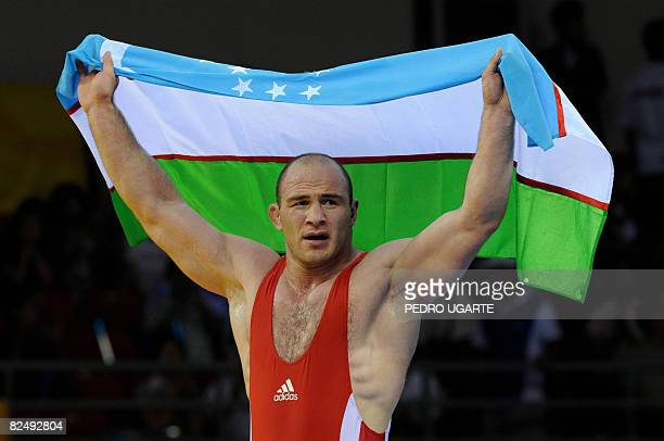 Uzbekistan's Artur Taymazov celebrates victory in the men's freestyle 120kg final wrestling match medal ceremony at the 2008 Beijing Olympic Games on...