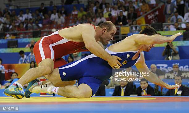 Uzbekistan's Artur Taymazov fights with Bakhtiyar Akhmedov of Russia at the men's freestyle 120kg final wrestling match at the 2008 Beijing Olympic...