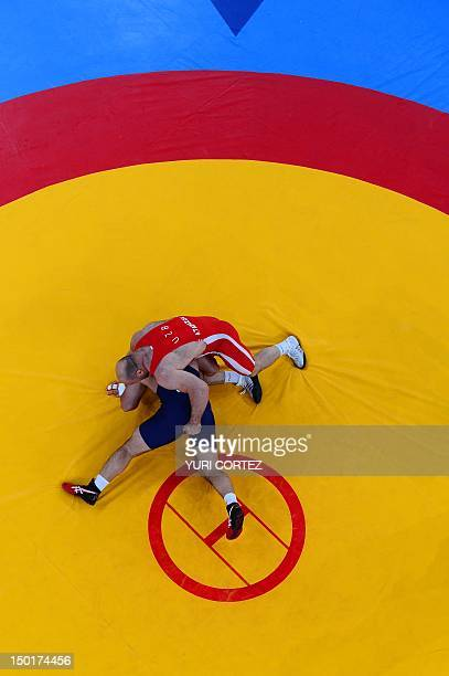 Uzbekistan's Artur Taymazov wrestles Georgia's Davit Modzmanashvili in their Men's 120kg gold medal match on August 11 2012 during the wrestling...