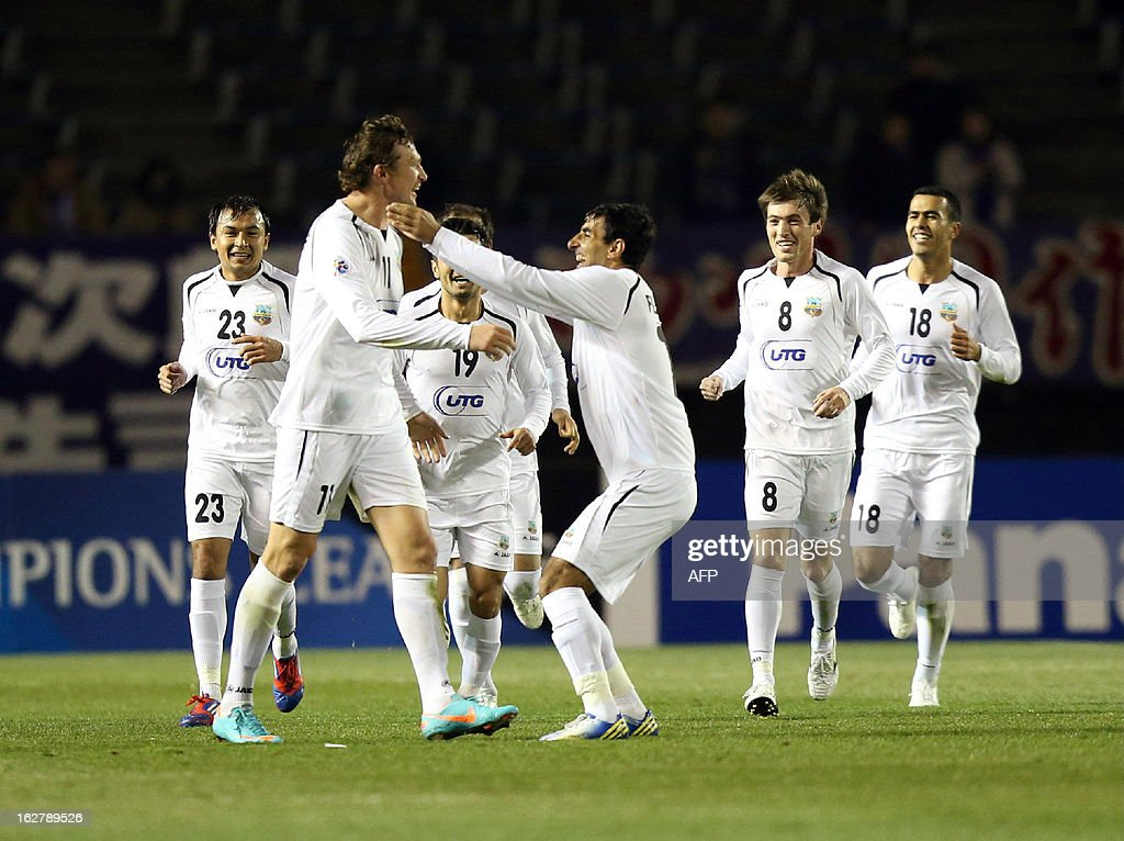 Uzbekistan's Bunyodkor forward Oleksandr Pyshur (2nd L) is congratulated by his teammates after he scored a goal against Japan's Sanfrecce Hiroshima during the AFC champions league group G match in Hiroshima, western Japan on February 27, 2013. Bunyodkor led the game 1-0 after the first half.