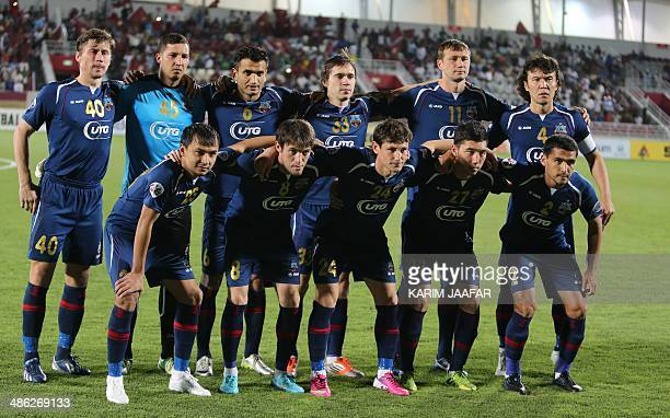 Uzbekistan's Bunyodkor players pose for a family picture before their AFC Champions League football match against Qatar's ElJaish in Doha on April 23...