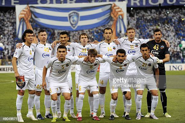Uzbekistan's Bunyodkor team players pose for a group picture before their AFC Champions League round 16 qualifying football match against Saudi...