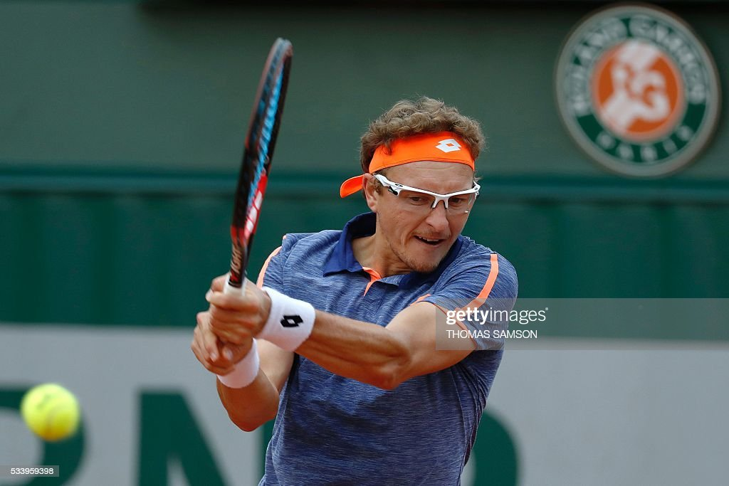 Uzbekistan's Denis Istomin hits a return to Argentina's Juan Monaco during their men's first round match at the Roland Garros 2016 French Tennis Open in Paris on May 24, 2016. / AFP / Thomas SAMSON