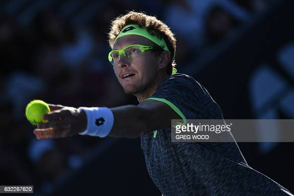TOPSHOT Uzbekistan's Denis Istomin serves against Spain's Pablo Carreno Busta during their men's singles third round match on day six of the...