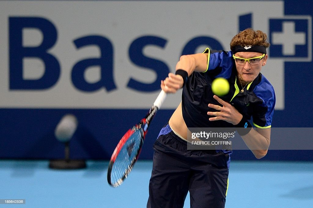 Uzbekistan's Denis Istomin serves during his match against Switzerland's Roger Federer on October 23, 2013 at the Swiss Indoors tennis tournament in Basel.