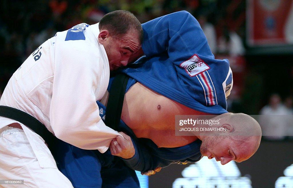 Uzbekistan's Dilshod Choriev (white) fights against France's Vincent Massimino (blue) on February 10, 2013 in Paris, during the eliminatories of the Men -90kg of the Paris Judo Grand Slam tournament.