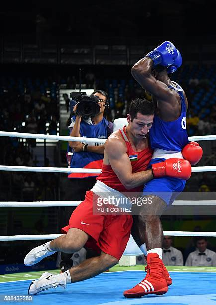 TOPSHOT Uzbekistan's Elshod Rasulov is knocked out by Great Britain's Joshua Buatsi during the Men's Light Heavy match at the Rio 2016 Olympic Games...