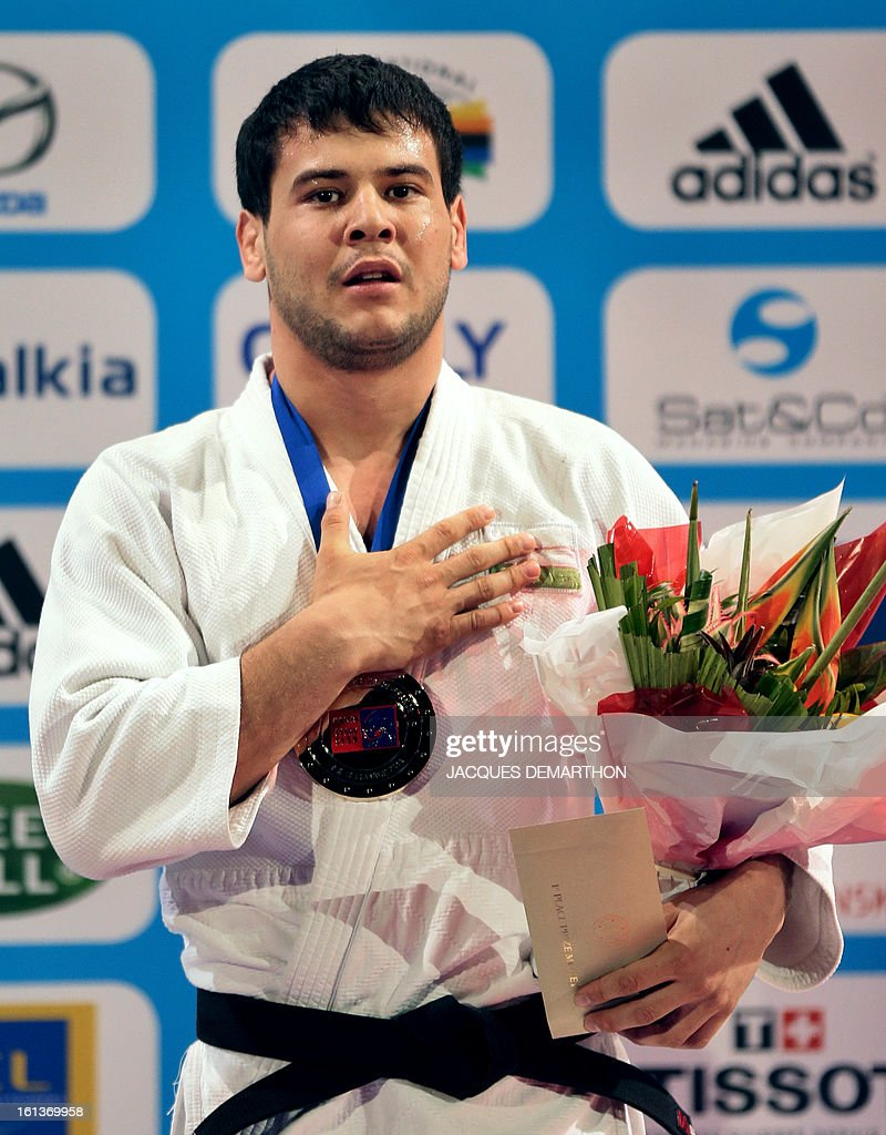 Uzbekistan's gold medalist Yakhyo Imamov listens to his national anthem on the Men -81kg contest final match of the Paris' Judo Grand Slam tournament on february 10, 2013 in Paris. AFP PHOTO / JACQUES DEMARTHON