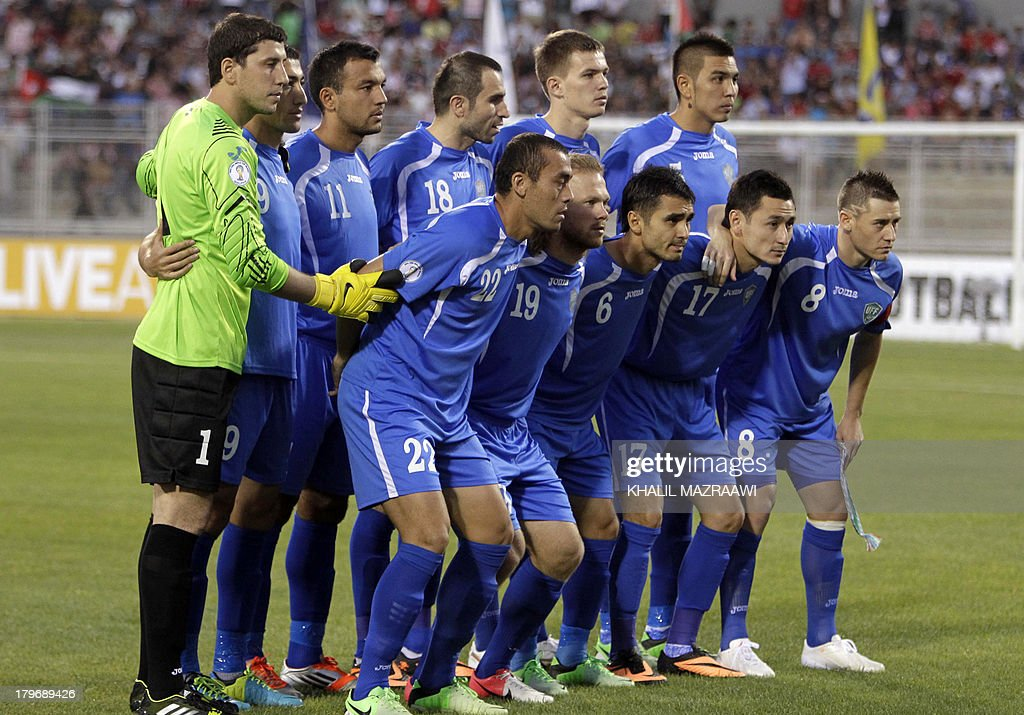 Uzbekistan's national team pose for a photo prior to their 2014 World Cup qualifier football match against Jordan at the King Abdullah international...