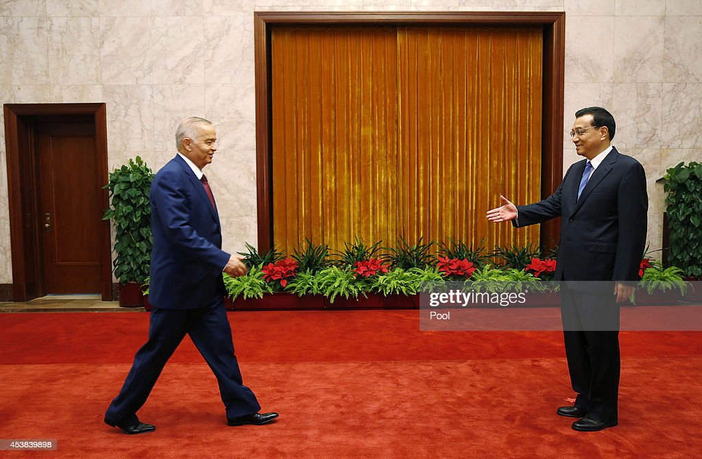 Uzbekistan's President <a gi-track='captionPersonalityLinkClicked' href=/galleries/search?phrase=Islam+Karimov&family=editorial&specificpeople=563286 ng-click='$event.stopPropagation()'>Islam Karimov</a> approaches to shake hands with Chinese Premier <a gi-track='captionPersonalityLinkClicked' href=/galleries/search?phrase=Li+Keqiang&family=editorial&specificpeople=2481781 ng-click='$event.stopPropagation()'>Li Keqiang</a> at the Great Hall of the People on August 20, 2014 in Beijing, China.